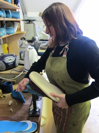 Laia putting the last inside her handmade artisan shoes